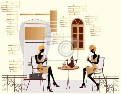 2 czacie dziewczyny w kawiarni