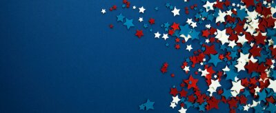 Fototapeta 4th of July American Independence Day stars decorations on blue background. Flat lay, top view.