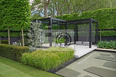 Fototapeta A cool modern garden with some Scandinavian style and a water feature