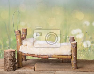 Fototapeta A noworodka studio łóżko cyfrowe prop wykonane z japońskiego klonu oddziałów drzewa z dandelion zielonej łące tle charakteru.