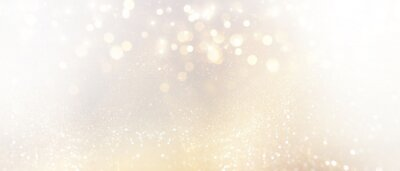 Fototapeta abstract glitter silver and gild lights background. de-focused