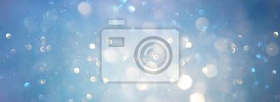 Fototapeta abstract glitter silver, gold , blue lights background. de-focused. banner