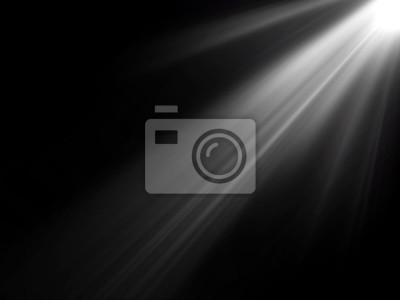 Fototapeta Abstrakcyjne piękne promienie światła na czarnym tle.