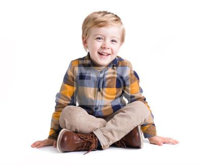 Fototapeta Adorable małe dziecko siedzi na podłodze, odizolowane na białym bacground