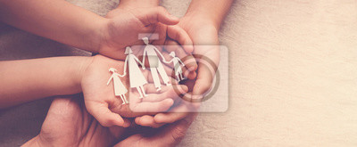 Fototapeta Adult and children hands holding paper family cutout, family home, foster care, homeless support concept