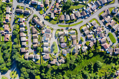Fototapeta Aerial drone view of small winding sreets and roads in a residential area of a small town