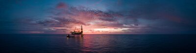 Fototapeta Aerial panorama view from a drone of an offshore jack up rig during sunset time at the offshore location