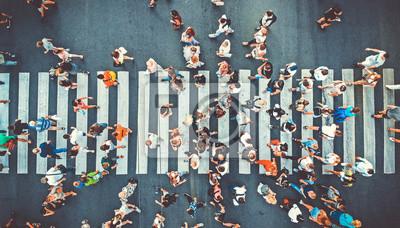 Fototapeta Aerial. People crowd on pedestrian crosswalk. Top view background. Toned image.