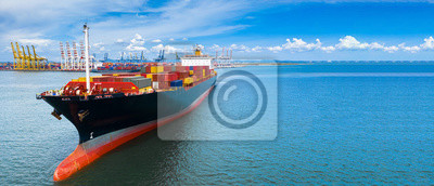Fototapeta Aerial side view container ship carrying container in import export business logistic and transportation of international by container ship in the open sea, with copy space.