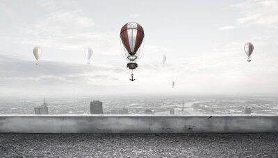 Fototapeta Aerostaty latające nad niebem. Różne środki przekazu