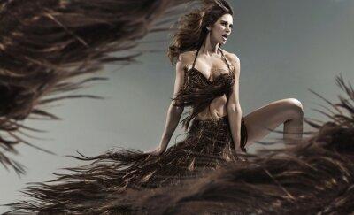 Fototapeta Alluring młoda brunetka wśród burzy włosów