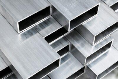 Fototapeta Aluminium profile for windows and doors manufacturing. Structural metal aluminium shapes. Aluminium profiles texture for constructions. Aluminum constructions factory background.