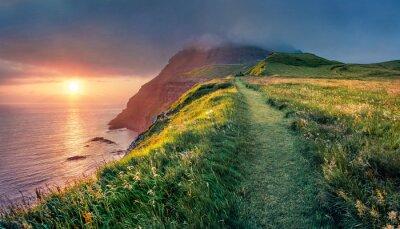 Fototapeta Amazing summer scene from Sunset Viewpoint in Gasadalur village. Fantastic evening landscape of Vagar island. Fantastic seascape of Atlantic ocean, Faroe Islands, Denmark, Europe.