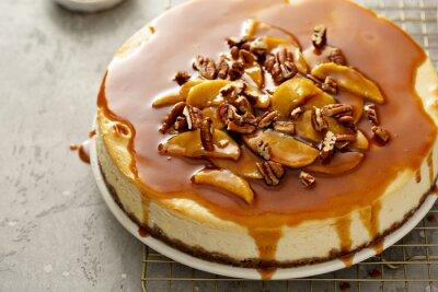 Fototapeta Apple caramel pecan cheesecake with dripping sauce