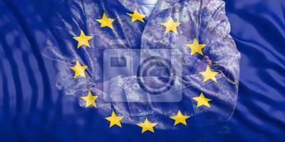 Fototapeta Armia UE. Flaga Unii Europejskiej i wyblakły żołnierz z skrzyżowanymi rękami. 3d ilustracja