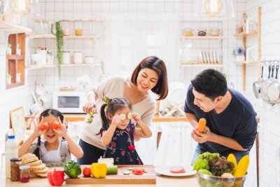Fototapeta Asian family enjoy playing and cooking food in kitchen at home