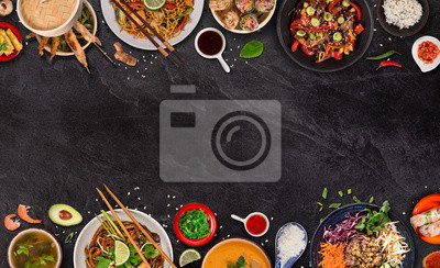 Fototapeta Asian food background with various ingredients on rustic stone background , top view. Vietnam or Thai cuisine.