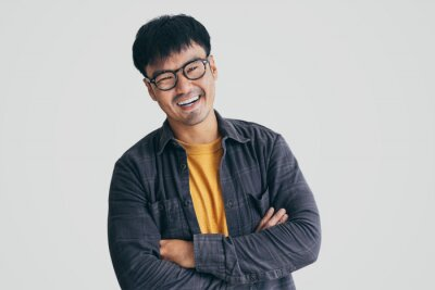 Fototapeta asian man portrait young male wear eye glasses smiling cheerful look thinking position with perfect clean skin posing on white background.fashion people life style concept