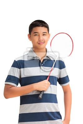 Fototapeta Asian nastolatka chłopiec trzyma rakietę do badmintona, samodzielnie na białym tle