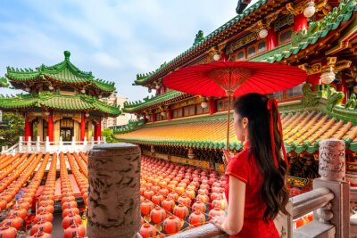 Fototapeta Asian woman in chinese dress traditional at Sanfeng Temple in Kaohsiung, Taiwan.