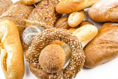 Fototapeta Assorted breads isolated on a white background.