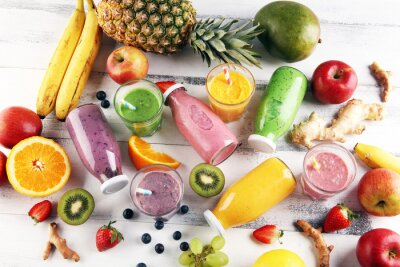 Assortment of fruit smoothies in glass bottles. Fresh organic Smoothie ingredients. Smoothies for health or detox diet food