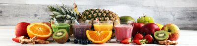 Assortment of fruit smoothies in glasses. Fresh organic Smoothie ingredients. Smoothies for health or detox diet food