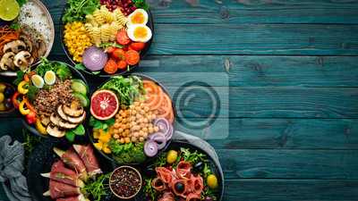 Fototapeta Assortment of healthy food dishes. Top view. Free space for your text.