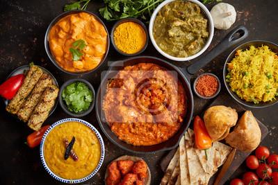 Fototapeta Assortment of various kinds of Indian cousine on dark rusty table