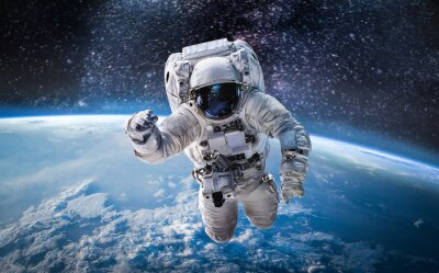 Fototapeta Astronaut in the outer space over the planet Earth. Abstract wallpaper. Spaceman. Elements of this image furnished by NASA