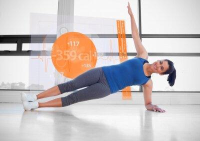 Fototapeta Atrakcyjna kobieta robi joga z futurystycznym interfejsem obok on