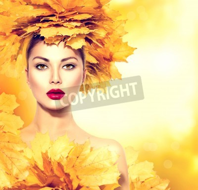 Fototapeta Autumn woman with yellow leaves hair style