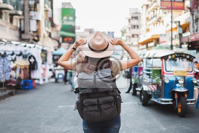 Fototapeta Back view Asian woman tourist backpacker travel in Khao San road, Bangkok, Thailand