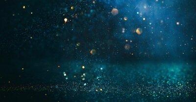 Fototapeta background of abstract glitter lights. gold, blue and black. de focused