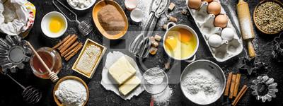 Fototapeta Baking background. Flour and various ingredients for dough.