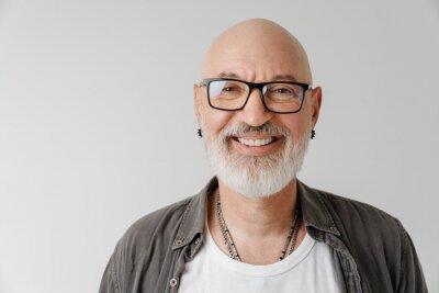 Fototapeta Bald european man in eyeglasses laughing and looking at camera