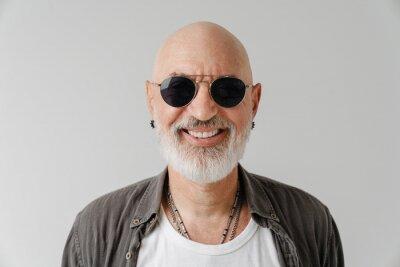 Fototapeta Bald european man in sunglasses laughing and looking at camera