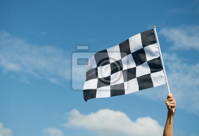 Fototapeta Banderą wyścigową w ręku.