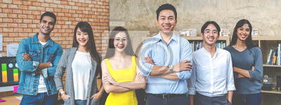 Fototapeta Banner of Group asian employee are standing and looking at camera with feeling confident at workplace company. Portait of Asian creative team posing in workspace.