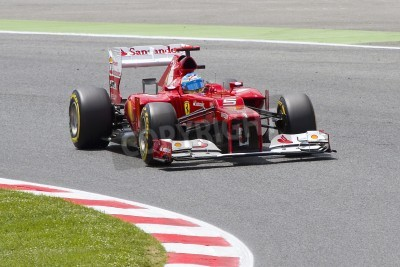 Fototapeta BARCELONA - MAY 12: Fernando Alonso of Ferrari F1 team racing at Qualifying Session of Formula One Spanish Grand Prix at Catalunya circuit, on May 12, 2012 in Barcelona, Spain