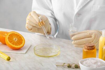 Fototapeta Beautician preparing natural cosmetic in laboratory, closeup