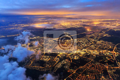 Fototapeta Beautiful aerial cityscape view of the city of Leiden, the Netherlands, after sunset at night in the blue hour