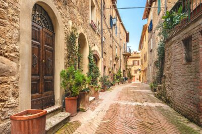 Fototapeta Beautiful and colorful streets of the small and historic Tuscan