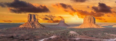 Fototapeta Beautiful dramatic sunset over the East, West Mitten Butte and Merrick Butte in Monument Valley. Utah, USA. Panoramic photo