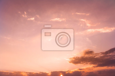 Beautiful golden  sunset sky with colorful clouds.