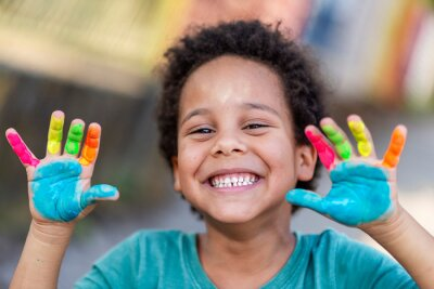 Fototapeta beautiful happy boy with painted hands