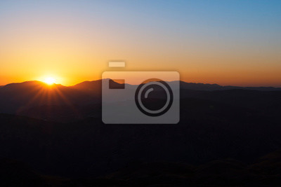 Beautiful landscape, golden sunset over the mountains. View from Nemrut Mountain, Turkey.