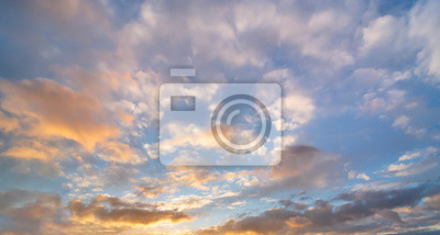 Beautiful sunset sky. Dramatic colorful clouds after sunset. Nature backgrounds.