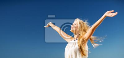 Fototapeta beautiful woman enjoying summer outdoors
