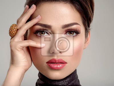 Fototapeta Beautiful young fashion woman with living coral lipstick. Attractive white girl wears luxury jewelry.